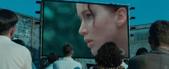 Movie Still: District 12 Watches The Games