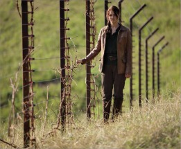 Katniss at The District 12 Fence