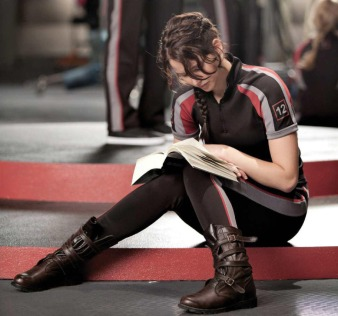 Movie Still: Katniss in The Training Room Reading a Book