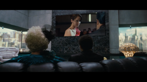 Movie Still: Effie and Cinna Watching The Interview