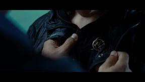 Movie Still: Cinna, Katniss & Mockingjay Pin