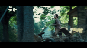 Movie Still: Katniss Running in District 12