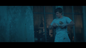 Movie Still: Peeta at The Bakery