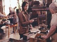 Movie Still: Katniss Barters in The Hob