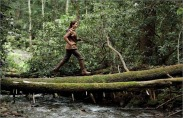 Movie Still: Katniss Running through Woods in District 12