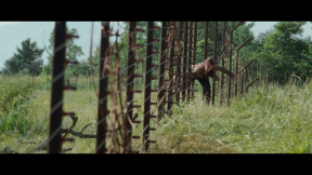 Movie Still: Katniss at The District 12 Fence